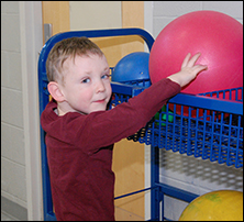 Boy Playing with a Ball