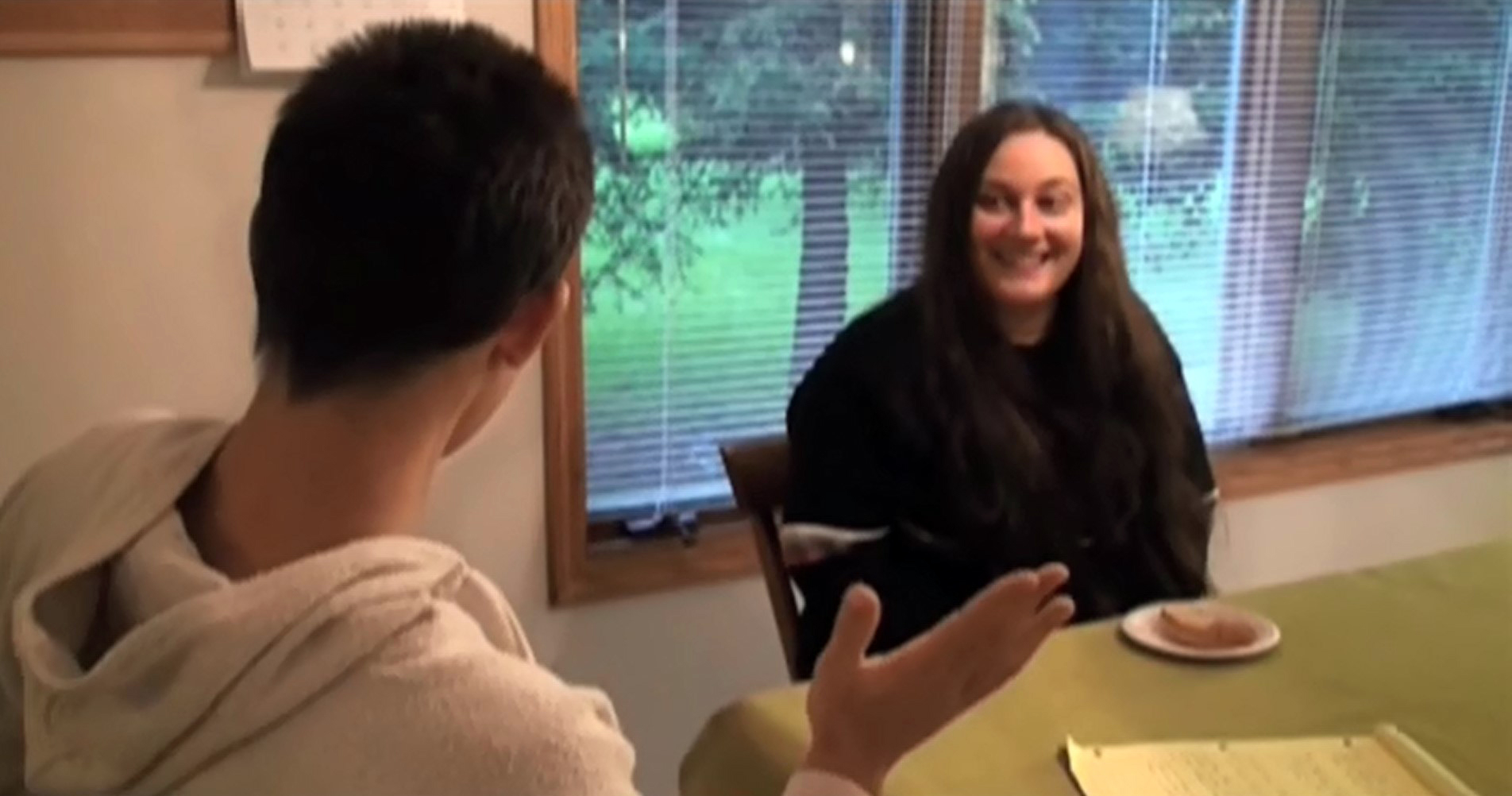 Image of two people talking