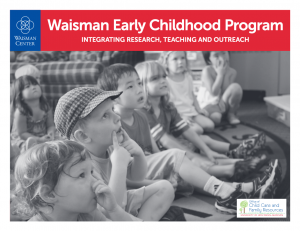 "Front of ""Waisman Early Childhood Program: Integrating Research, Teaching, and Outreach."" Seven preschool-aged children sitting next to each other on the floor looking upward."