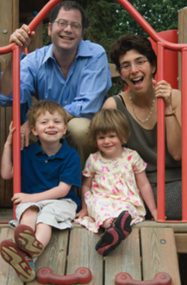 Seth Pollack, Jenny Saffran, boy and girl on an outdoor a play set
