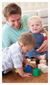 Dad with two sons playing with blocks. page 12