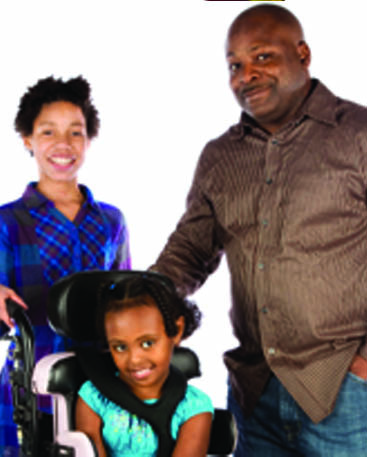 mom, dad and daughte in wheelchair page 28