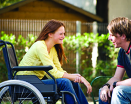Woman in a wheelchair interacting with an adult. Page 37