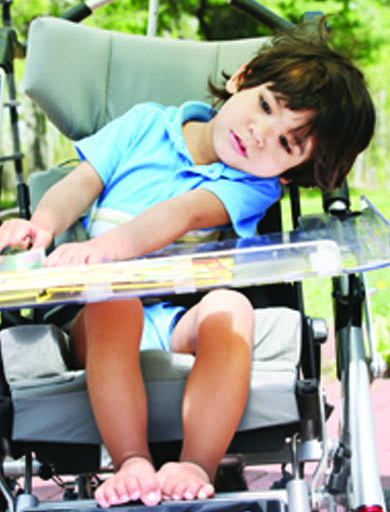 Young boy sitting in wheelchair. Page 34