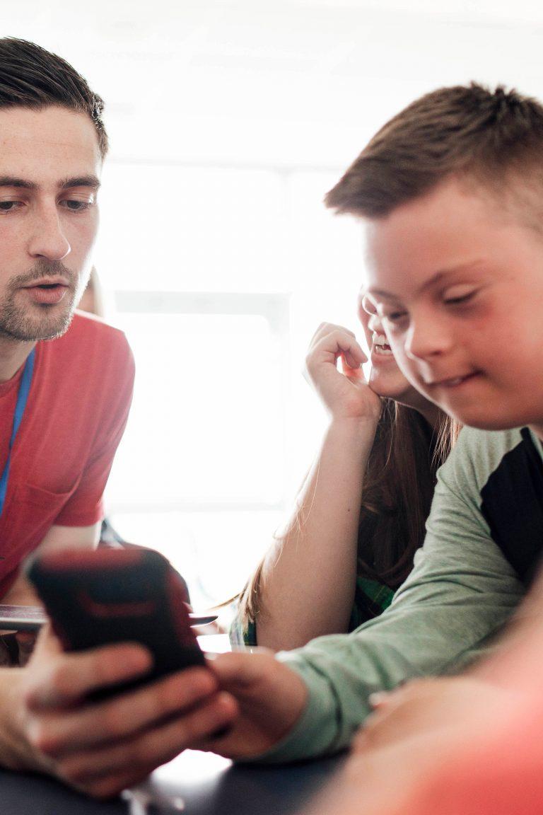 boy with friend helping him