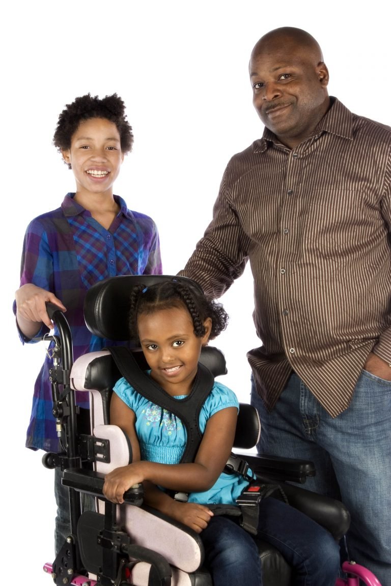 Mom, Dad and daughter is in a wheelchair.